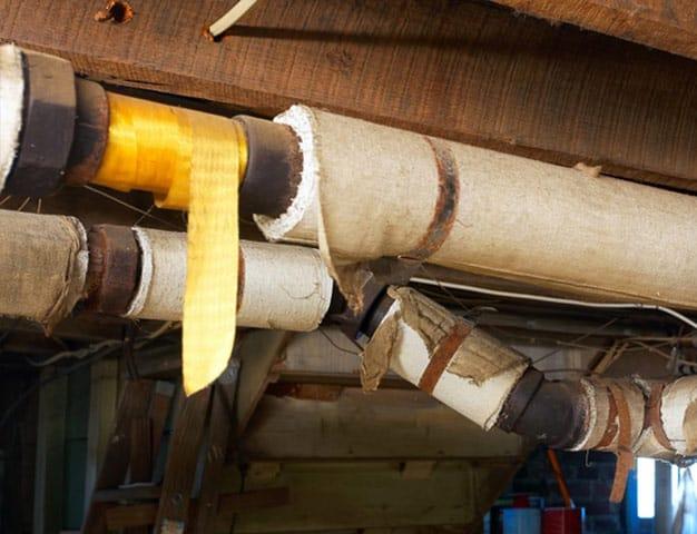 Asbestos insulation around pipes